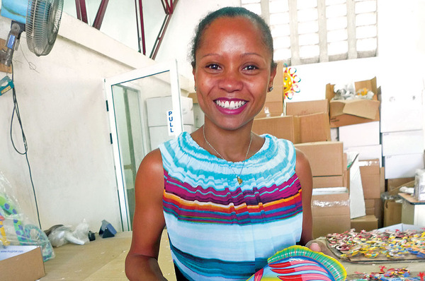 Magalie Dresse, co-owner of Caribbean Craft in Port-au-Prince, Haiti. Photo by Gary G. Yerkey.